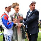 "Jockey Danny Nikolic and trainer Robert Smerdon posed with silverware they nicked from the clubhouse after the  Sex In The City  star won the $1 million Oaks by nine lengths at Flemington Racecourse in Australia. According to theaustralian.com, Nikolic said his mount ""felt 'nice and relaxed and went to sleep' before he released the handbrake at the business end."""