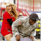 With naked livestock running about Texas Motor Speedway, the Army was called in and PFC Robert Philips of Fort Hood, aided by Ashton Theiss, threw cover on this goat or sheep or wallaby or whatever it is.