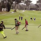 With the economy in la toilette and golfers not tipping like they used to, greenskeepers have been reduced to searching for coins that fall out of contestants' pockets. Here are they are apparently doing just that at the big tournament in San Francisco.
