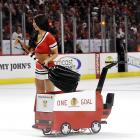 Cleaning up after the elephants during a break in the exciting NHL action at Chicago's United Center.