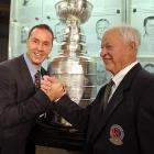 The freshly-minted Hockey Hall of Famer (left) armwrestled Mr. Hockey for the right to take home the punch bowl (rear) after the induction ceremony party in Toronto on November 11. We hear ol'  Gordie won in a shootout that sent everyone diving for cover.