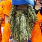 Looks like this feller could use a shave and a haircut as he peruses the big basketball game between the  Boise State Broncos and the Utah Utes at Taco Bell Arena somewhere in Idaho.