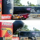 NHRA funny car driver Melanie Troxel drives her car funny and ends up roaring into some inflatable signage after her throttle gets stuck at Auto Club Raceway in Pomona. Troxel was OK after the incident, the inflatable signage, alas, was not.