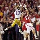 Alabama quarterback A.J. McCarron throws to the wrong No. 17. Morris Claiborne's pick was one of the Tigers' two interceptions.