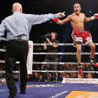 Pier-Olivier Cote of Canada celebreates winning the IBF super lightweight championship. Cote knocked out Jorge Luis Teron of the U.S. in the second round.