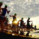 Competitors enter the water during the Brighton Triathlon in Australia.