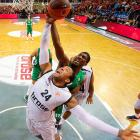 Athens' P.J. Tucker (24) and Bamberg's Steven Smith fight for a rebound during a Euro League Basketball game.