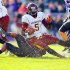 Northwestern linebacker David Nwabuisi tackles Minnesota quarterback Marqueis Gray during the Wildcats' 28-13 victory.