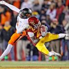 Cyclones wideout Darius Darks hauls in a pass while being defended by Oklahoma State corner Justin Gilbert. Iowa State upset the second-ranked Cowboys 37-31 at Jack Trice Stadium in Ames.