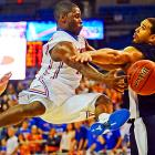 Florida guard Erving Walker passes the ball past North Florida's Andy Diaz in the second half of the Gators 91-55 win. Walker had a team-high five assists to go along with his 17 points.