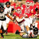 Rutgers fullback Joe Martinek runs past Cincinnati defenders after catching a pass from quarterback Chas Dodd in the Scarlett Knights 20-3 win.