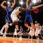 Spartans' forward Draymond Green passes around a Duke defender in Michigan State's 74-69 loss. The win put Blue Devils' coach Mike Krzyzewski past Bobby Knight to become the NCAA's all-time winningest men's coach with 903 career victories.