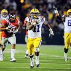 In a week full of BCS upsets, Spencer Ware and the Tigers remained undefeated. Ware had 70 rushing yards and a touchdown in LSU's 52-3 win over Ole Miss.