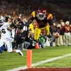 USC wideout Marqise Lee dives into the end zone for a touchdown in the Trojans' 50-0 rout of UCLA. Lee had 224 receiving yards and two scores.