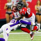 Falcons wide receiver Roddy White (right) eludes a tackle attempt from Minnesota defensive back Marcus Sherels during Atlanta's 24-14 win on Nov. 27. White finished with 120 yards and a touchdown.
