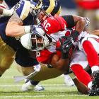 St. Louis fullback Brit Miller yanks Arizona running back LaRod Stephens-Howling's facemask during the Cardinals' 23-20 win over the Rams on Nov. 27.