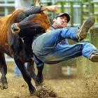 Hawaiian cowboy Cody Cabral practices steer wrestling for his upcoming rookie season in California.