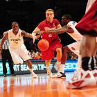 Stanford guard Aaron Bright (center) penetrates the Oklahoma State defense during a NIT Season Tip-Off semifinal. Stanford won 82-67 but lost to Syracuse in the final.