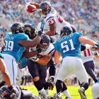 Arian Foster (23) leaps over the pile to score his only touchdown in Houston's 20-13 victory over the Jacksonville Jaguars.