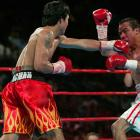 Manny Pacquiao and Juan Manuel Marquez have met in two of the most competitive, evenly matched fights of the past decade. And while the first was a controversial draw and the second a one-point split decision for Pacquaio, a strong case can be made that Marquez won both. Here's a look back at some of the memorable images from the 24 rounds they've spent heightening each others' legacies.