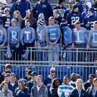 """These Penn State students painted """"For The Kids"""" on their chests."""
