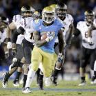 Derrick Coleman (pictured) scored the go-ahead touchdown from the one-yard line with 49 seconds left to help UCLA pull off a 29-28 upset over Arizona State. ASU's Alex Garoutte missed a 46-yard field goal as time expired that would have given his team the lead. The Bruins (5-4, 4-2 Pac-12) now improbably move into first place in the Pac-12 South.