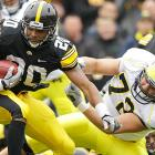 Iowa broke up the three-way tie atop the Big Ten Legends Division with its third straight win over Michigan. The Hawkeyes (6-3, 3-2 Big Ten) moved even with Michigan in the division, just behind Nebraska and Michigan State. Marcus Coker led the way with 132 rushing yards and two touchdowns. Denard Robinson was held to 17-of-37 passing for 194 yards, including a Christian Kirksey interception (pictured), and 55 rushing yards for the Wolverines (7-2, 3-2).