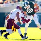 Michigan State trailed 24-21 going into the fourth quarter, but Le'Veon Bell's 35-yard touchdown run with 11 minutes left proved the winning score. The Spartans (7-1, 4-1 Big Ten) stayed in the thick of the Legends Division race with Michigan losing. Kirk Cousins completed passes to seven different receivers, including tight end Brian Linthicum (pictured), for 295 yards. The Gophers fell to 2-7 and 1-4 in the Big Ten.