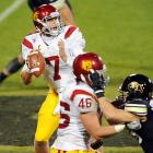 Matt Barkley set a school record with six touchdown passes as the Trojans romped over the Buffaloes. In all, Barkley completed 25-of-39 passes for 318 yards. USC (7-2, 4-2 Pac-12) also had four rushers average better than six yards per carry. Tyler Hansen was held to 17-of-37 passing for Colorado (1-9, 0-6), which has lost seven straight.