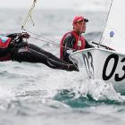 "Croatia's Sime Fantela (left) tries to gain an edge using his flexibility during the men's 470 class gold medal race on Dec. 11. The pair went on to win bronze. ""We fought really hard,"" Igor Marenic (right) said. ""We deserve the bronze."""