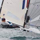 American Zach Railey pulls ahead of the competition in the Finn class gold medal race on Dec. 11. While Zach didn't capture gold, his sister, Paige, won bronze in the Laser Radial class.