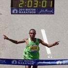 "Even with an encyclopedia, it may not be possible to keep up with what constitutes a world record or world best or merely a really fast time that doesn't count for anything official in the marathon. So simply say this for the 2:03:02 that Kenya's Mutai turned in: It was possibly the greatest marathon ever run. While Mutai's time stands as the fastest in history, it cannot be considered an official world record because the Boston course has an elevation drop of roughly 450 feet from the start in Hopkinton to the finish in downtown Boston. Still, anyone who has run or been around the race knows that the particulars of the course -- unnecessary downhills at the start and demanding uphills, including the so-called ""heartbreak hill,"" over the last portions of the race -- make it more difficult than many that are flatter, faster and legal for record purposes."