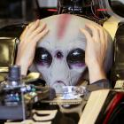 They say aliens do the jobs that most Americans don't want, and that obviously extends to piloting mankind's most advanced race cars. However, this little feller from the Crab Nebula appears to be a bit vexed by how to start his Formula One racer at Interlagos racetrack in Sao Paulo, Brazil.