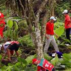 The mission in them there hills is to find the damn ball. Rhys Davies (center), Jamie Donaldson (front left), Yuta Ikeda (front right) andTetsuji Hiratsuka (front, second from right) tried to do just that. Their quest took them somewhere off the sixth fairway in Haikou, China.