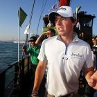 Rory McIlroy (right), Ian Poulter (center) and Yang Yong-eun (left) navigate a rather considerable water hazard aboard a Chinese junk.  Sports Pop Quiz:  If boats are stored in a boatyard, are junks stored in a junkyard? And if so, is there a dog to beware of?