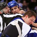 Love triangle: Referee Dan O'Halloran appears to have a man crush on Brandon Dubinsky of the New York Rangers who clearly has a thing for from Marc-Andre Bergeron of the Tampa Bay Lightning.
