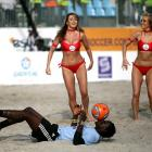 One surefire way to entice the ladies: make like a trained seal, as this fellow did during halftime of a match between Nigeria and South Africa at Lagos Island.