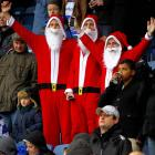 Season's greetings from  Did You See That? , America's only entirely elf-produced photo gallery. We begin this inordinately festive week with three jolly Queens Park Rangers supporters spreading cheer at their team's match against  Manchester United in London.