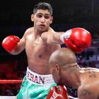 At 17, Khan captured silver at the Athens Olympics to become the youngest-ever boxer from the U.K. to win a medal. He unified the titles in the 140-pound division, running his record to 26-1 with 18 knockouts, before losses to Lamont Peterson and Danny Garcia.