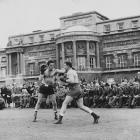The light heavyweight champion from 1948 to '50, the colorful Mills (left) retired as one of the most beloved figures in British sport. He walked away with a record of 77-8-6 and 48 knockouts.