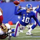 Redskins defensive end Darrion Scott sacks Giants quarterback Eli Manning during Washington's 23-10 victory.