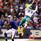 Dolphins cornerback Vontae Davis shows his athleticism, intercepting a pass intended for Bills wideout Stevie Johnson during Miami's 30-23 win on Dec. 18. It was Buffalo's seventh straight loss.