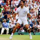 Novak Djokovic celebrates after winning his first career Wimbledon final. The Serbian native beat Rafael Nadal in four sets, 6-4, 6-1, 1-6, 6-3.