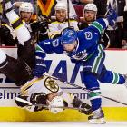 Canucks defensman Dan Hamhuis upends Milan Lucic during the 2011 Stanley Cup Finals. Lucic and the Bruins dropped the first two games, but rebounded to four of the next five to clinch their first NHL title since 1971-72.