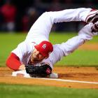 Cardinals ace Chris Carpenter dives onto first base to record an out during Game 1 of the 2011 World Series against the Texas Rangers. It was worth the effort. St Louis won the game -- and eventually the series.