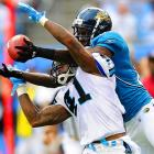 Carolina Panthers defensive back Captain Munnerlyn breaks up a pass intended for Jacksonville Jaguars wideout Jason Hill during their game on Sept. 25. Carolina won 16-10, giving rookie Cam Newton his first NFL victory.