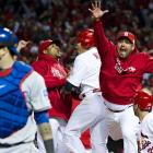 The St. Louis Cardinals rejoice after winning Game 7 of the 2011 World Series by a score of 6-2. Tony La Russa's club rallied to win Game 6 in dramatic fashion before shutting down the Rangers for the title the next day.