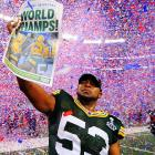 Packers linebacker Diyral Briggs holds up a celebratory newspaper after Super Bowl XLV. Green Bay escaped with a 31-25 win, staving off a late Steelers' comeback to secure the franchise's first title since 1996.