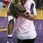 Kansas State guard Clent Stewart and his girlfriend Stephanie Harwell hug after Stewart's successful marriage proposal before K-State's basketball game against Colorado in 2008.