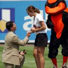 Jeff Rajaski proposes to Baltimore Orioles ballgirl Anaris Little during a game against the Philadelphia Phillies in 2002. The team mascot did not serve as the best man at the wedding.